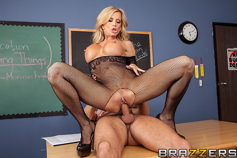 Busty teacher shows off her big tits and hourglass body 4