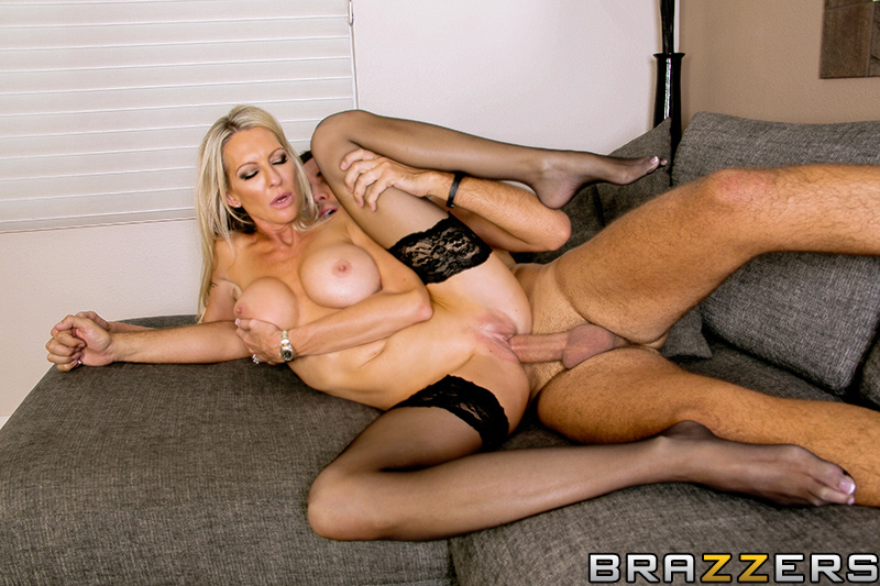 Blonde in latex stockings footjob to tranny