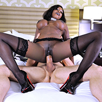 Diamond Jackson is a busty ebony call girl who loves big cocks, and Erik Everhard is the horny John who called her up. Only one problem, though: Erik is married to Diamond's sister! At first she says he can look but not touch, teasing him in her sexy lingerie, and stripping down to nothing but a pair of heels, some black stockings, and a set of garters. Her tune changes as soon as gets a glimpse of Erik's big dick, though! As soon as she gets her hands on that fat cock, she has to stroke it, suck it, and fill all of her holes with it. Once Erik has fucked her in her mouth, pussy, and tight little ass, he blows a huge load all over her face. Here's hoping they can keep a secret!